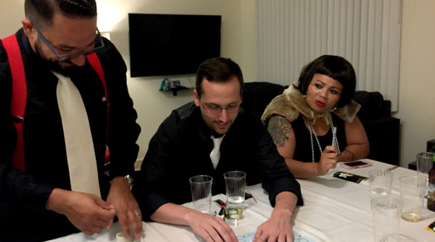 three people playing an escape game